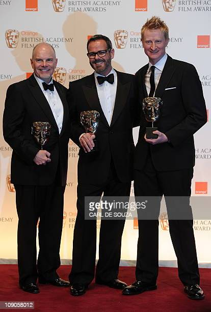 Doug Mowat Larry Dias and Guy Hendrix Dyas the winners of the 'Production design' award for 'Inception' pose for photographers at the British Academy...