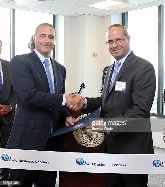 Doug Naidus CEO World Business Lenders and Deputy Mayor of Jersey City Marcos Vigil attend the World Business Lenders ribbon cutting in Jersey City...