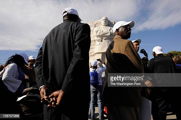 Doug Nelson left and Henry Wilson right take in the Martin Luther King Jr Memorial following its dedication on Sunday October 16 2011 in Washington...