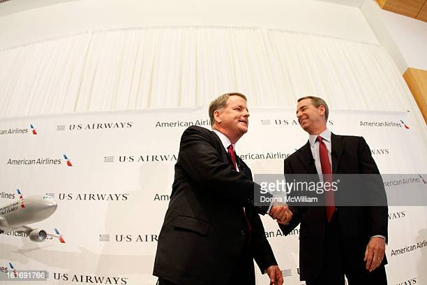 Doug Parker Chairman and CEO of US Airways and Thomas Horton Chairman President and Chief Executive Officer of American Airlines shake hands after a...
