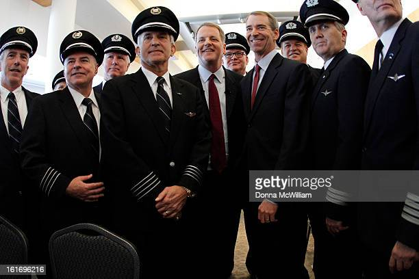 Doug Parker Chairman and CEO of US Airways and Thomas Horton Chairman President and Chief Executive Officer of American Airlines stand with pilots...