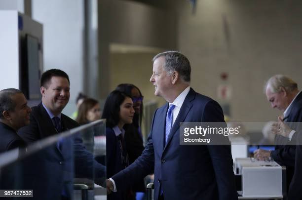 Doug Parker chairman and chief executive officer of American Airlines Group Inc greets employees during an event to mark the opening of five new...