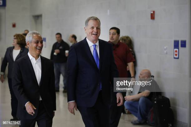 Doug Parker chairman and chief executive officer of American Airlines Group Inc right and Rahm Emanuel mayor of Chicago arrive for an event to mark...