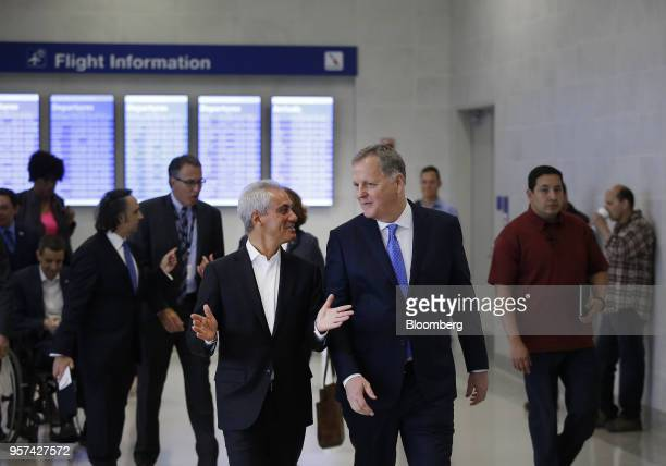Doug Parker chairman and chief executive officer of American Airlines Group Inc center right and Rahm Emanuel mayor of Chicago center left arrive for...