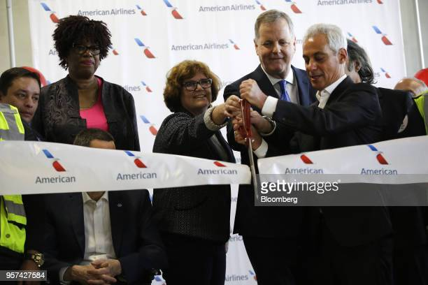 Doug Parker chairman and chief executive officer of American Airlines Group Inc center right cuts a ribbon with Rahm Emanuel mayor of Chicago right...