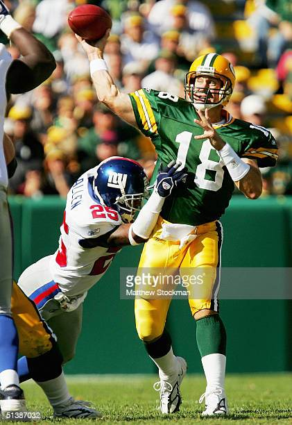 Doug Pederson of the Green Bay Packers throws under pressure by Will Allen of the New York Giants October 3 2004 at Lambeau Field in Green Bay...