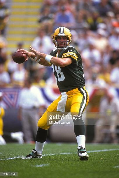 Doug Peterson of the DGreen bay Packers prepares to throw a pass during an NFL football game against the Dettriot Lions on September 1 1998 at...