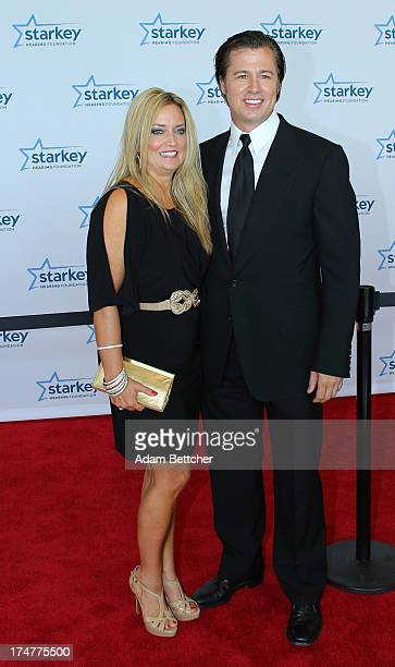 Doug Pitt and wife walk the red carpet before the 2013 Starkey Hearing Foundation's So the World May Hear Awards Gala on July 28 2013 in St Paul...