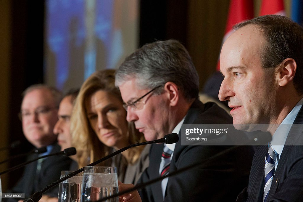 Doug Porter, deputy chief economist for BMO Capital Markets, from right, speaks while Craig Wright, chief economist of RBC Financial Group, Julia Coronado, chief economist of North America for BNP Paribas, Avery Shenfeld, chief economist of Canadian Imperial Bank of Commerce (CBIC), and Craig Alexander, chief economist of the Toronto-Dominion (TD) Bank Financial Group, listen at the Economic Club of Canada's 2013 Annual Economic Outlook breakfast in Toronto, Ontario, Canada, on Friday, Jan. 11, 2013. Canada's dollar fell from the strongest in three months versus its U.S peer as the nation's trade deficit widened to the fourth-largest on record, suggesting the economy is struggling to emerge from an export-driven slump. Photographer: Norm Betts/Bloomberg via Getty Images