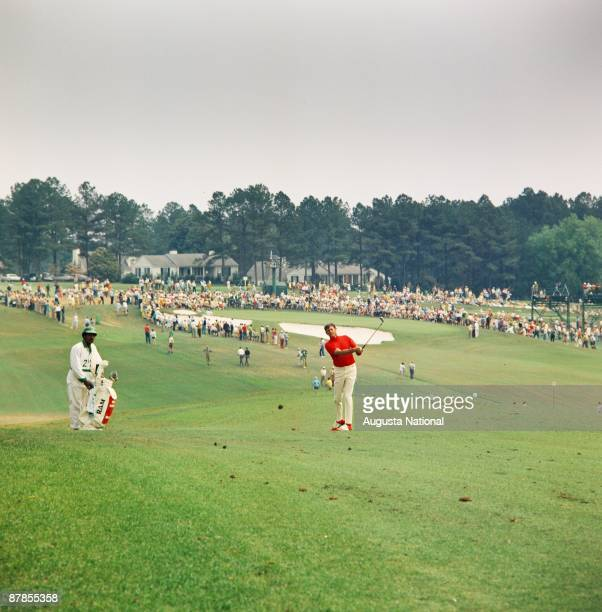 Doug Sanders hits off the first fairway next to his caddie during the 1969 Masters Tournament at Augusta National Golf Club on April 1969 in Augusta...