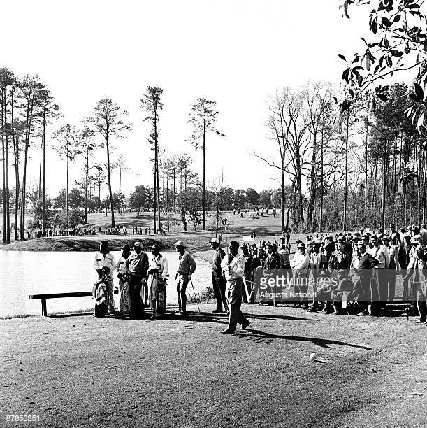 Doug Sanders tees off as Bob Goalby watches during the 1960 Masters Tournament at Augusta National Golf Club in April 1960 in Augusta Georgia
