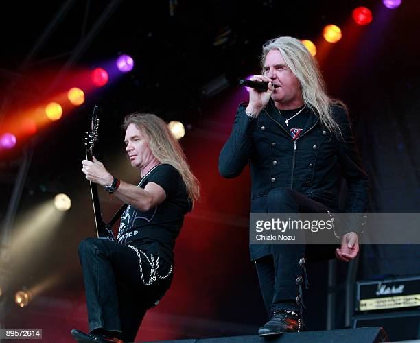 Doug Scarratt and Biff Byford of Saxon performs on stage at Knebworth House on August 2, 2009 in Stevenage, England.