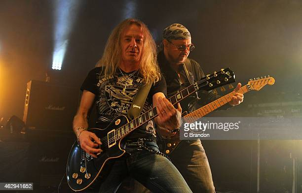 Doug Scarratt and Paul Quinn of Saxon perform on stage at Shepherds Bush Empire on February 7 2015 in London United Kingdom