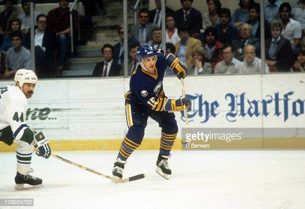 Doug Smith of the Buffalo Sabres skates on the ice during an NHL game against the Hartford Whalers on April 1 1986 at the Hartford Civic Center in...
