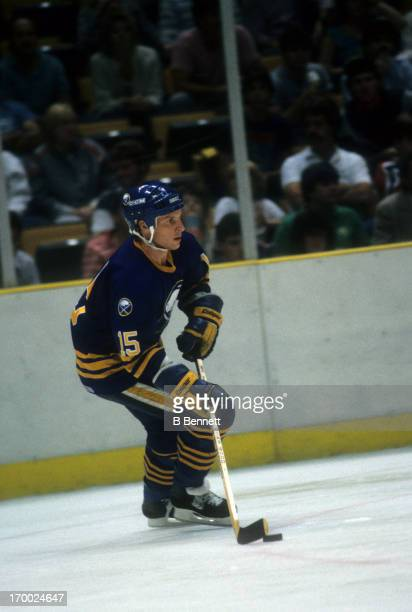 Doug Smith of the Buffalo Sabres skates with the puck during an NHL game against the Washington Capitals on October 18 1986 at the Captial Centre in...