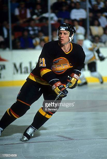 Doug Smith of the Vancouver Canucks skates on the ice during an NHL game against the Pittsburgh Penguins circa 1989 at the Pittsburgh Civic Arena in...