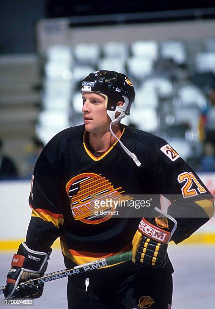 Doug Smith of the Vancouver Canucks skates on the ice during an NHL game against the New York Islanders on October 21 1989 at the Nassau Coliseum in...