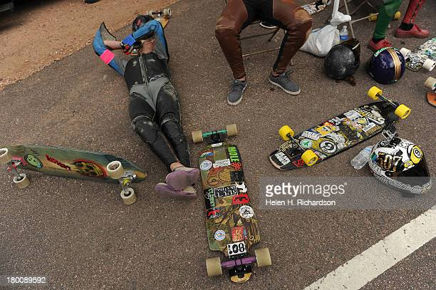 Doug Tolman rests on the ground surrounded by boards in between heats at the starting line of the taking part in the International Pikes Peak...