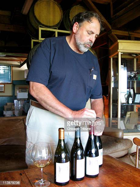 Doug Tunnell founder of Brick House Vineyards opens some bottles of wines at his winery in Newberg Oregon
