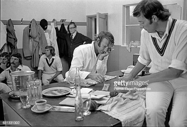 Doug Walters of Australia plays cribbage with teammate Rick McCosker in the Australian dressing room during the 1st Test match between England and...