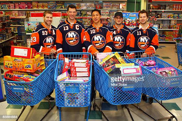 Doug Weight Bill Guerin Richard Park Freddy Meyer and Andy Hilbert of the New York Islanders go shopping for children in the hospital during the...