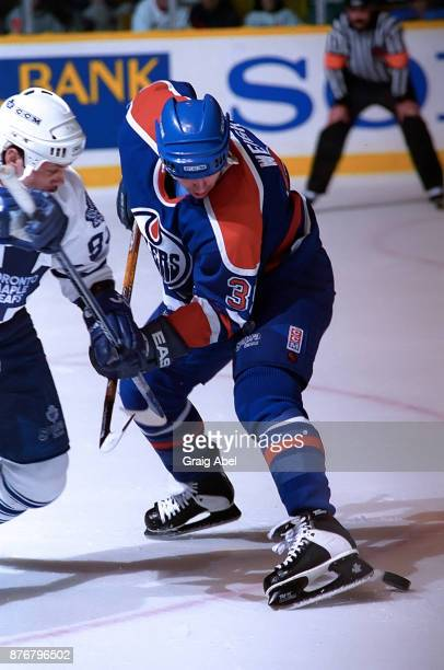 Doug Weight of the Edmonton Oilers skates against Doug Gilmour of the Toronto Maple Leafs during NHL game action on December 23 1995 at Maple Leaf...
