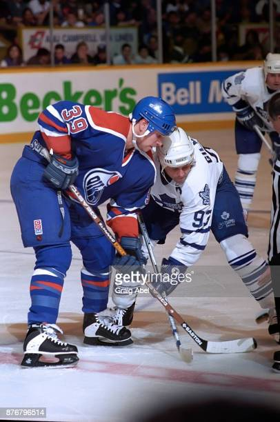 Doug Weight of the Edmonton Oilers skates against Doug Gilmour the of Toronto Maple Leafs during NHL game action on December 23 1995 at Maple Leaf...