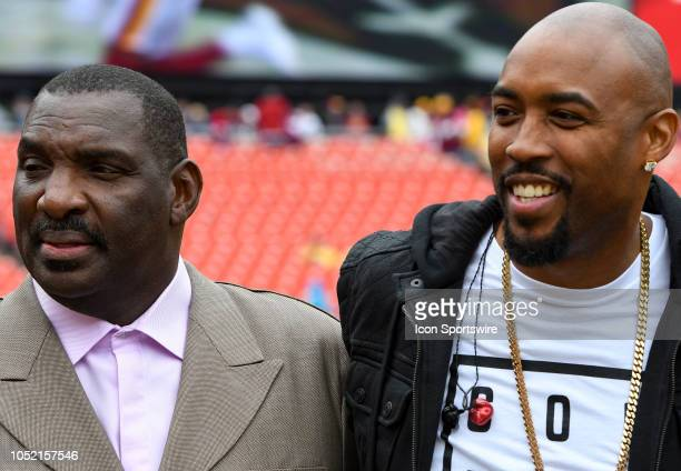 Doug Wiilliams Senior Vice President of Player Personnel for the Washington Redskins greets singer Montell Jordan on October 14 at FedEx Field in...