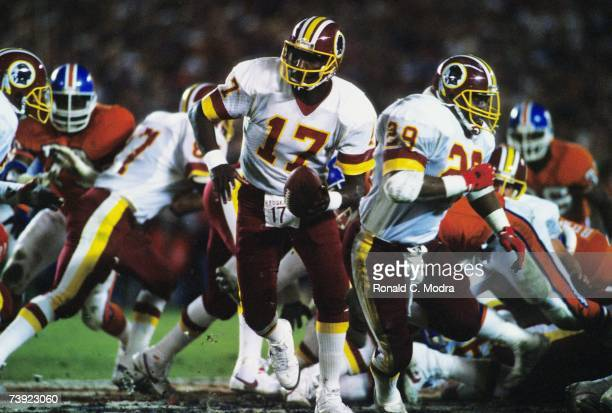 Doug Wiliams of the Washington Redskins handing off during Super Bowl XXII against the Denver Broncos on January 31 1988 in San Diego California