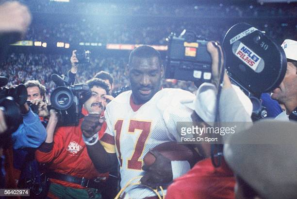 Doug Williams of the Washington Redskins walks past the media after winning the Super Bowl XXII against the Denver Broncos at Jack Murphy Stadium on...
