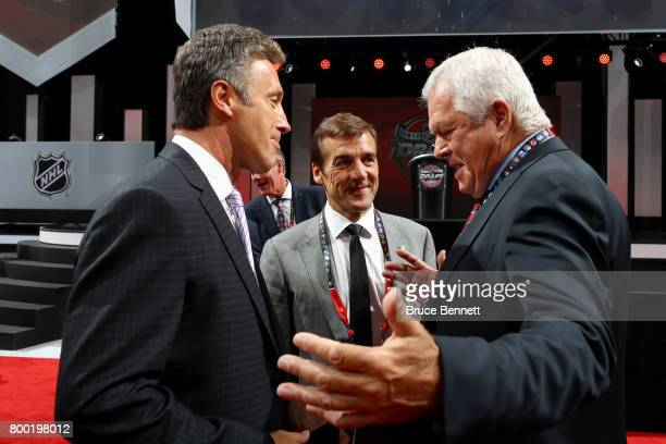 Doug Wilson George McPhee and Dale Tallon of the Vegas Golden Knights talk prior to the 2017 NHL Draft at the United Center on June 23 2017 in...