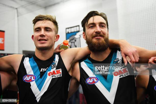 Dougal Howard and Charlie Dixon of the Power sing the club song after defeating the Suns during the round 23 AFL match between the Port Adelaide...