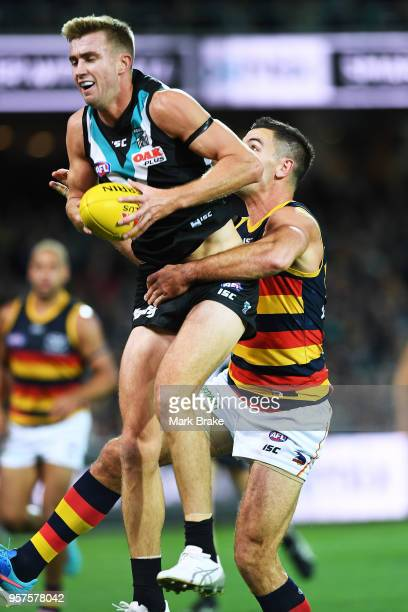 Dougal Howard of Port Adelaide marks in front of Taylor Walker of the Adelaide Crows during the round eight AFL match between the Port Adelaide Power...