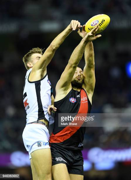 Dougal Howard of Port Adelaide rucks against Tom Bellchambers of the Bombers during the round four AFL match between the Essendon Bombers and the...