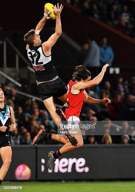Dougal Howard of Port Adelaide spoils Mark Baguley of the Bombers during the round 23 AFL match between Port Adelaide Power and the Essendon Bombers...