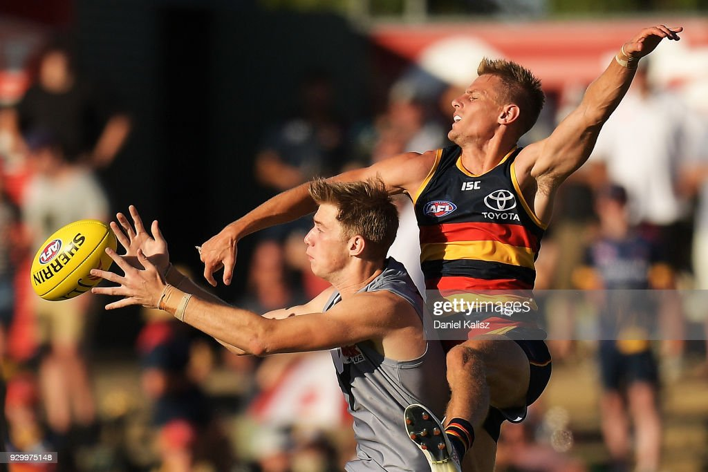 Dougal Howard of the Power and David Mackay of the Crows compete for the ball during the JLT Community Series AFL match between Port Adelaide Power and the Adelaide Crows at Alberton Oval on March 10, 2018 in Adelaide, Australia.