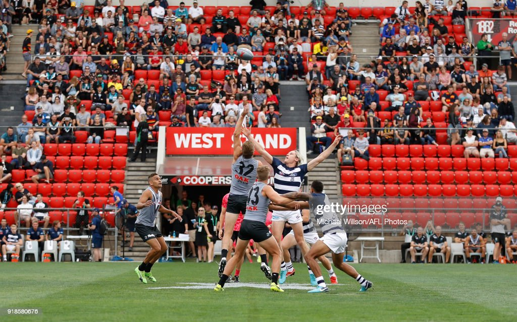 Dougal Howard of the Power and Mark Blicavs of the Cats contest the first bounce during the AFLX match between the Port Adelaide Power and the Geelong Cats at Hindmarsh Stadium on February 15, 2018 in Adelaide, Australia.