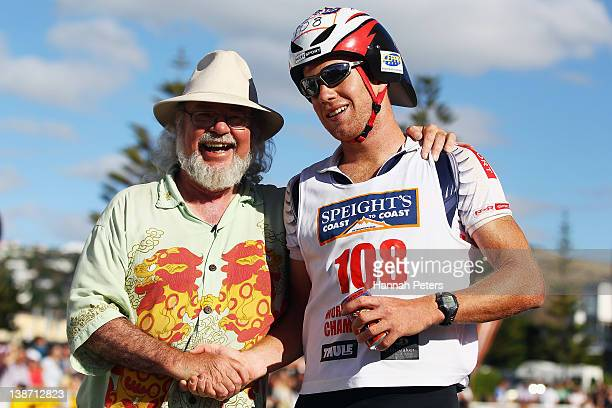 Dougall Allan celebrates with race director Robin Judkins after finishing second the Individual One Day event during the 2012 Speights Coast to Coast...