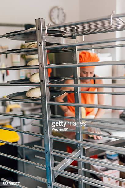 Dough balls on rack in a kitchen