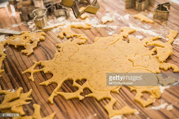 Dough rolled out and various shape cookies cut out with different cutters, Munich, Bavaria, Germany