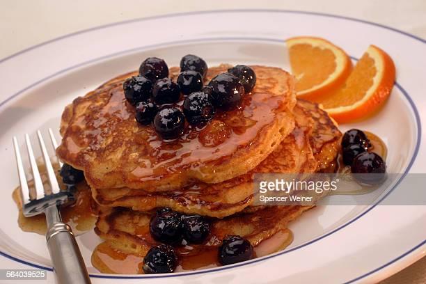 Doughboys cornmeal pancakes with blueberry sauce