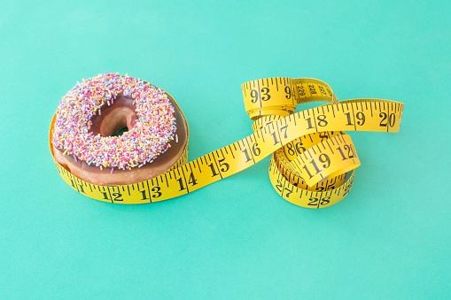Doughnut and tape measure - gettyimageskorea