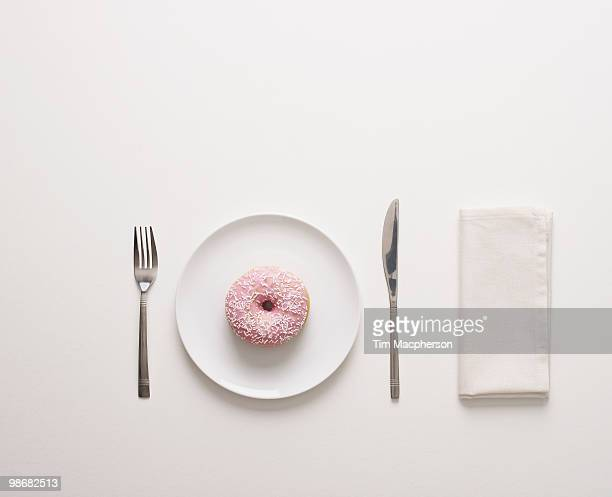 a doughnut on a plate - napkin stock pictures, royalty-free photos & images