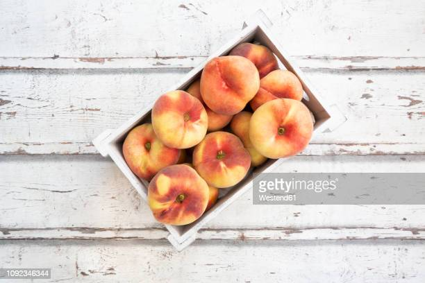 doughnut peaches in wooden box on white wood - peach tree stock pictures, royalty-free photos & images