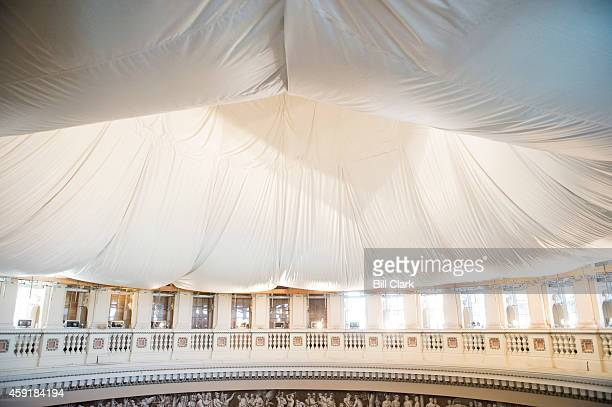 Doughnut shaped protective safety net hangs from the ceiling of the rotunda in the US Capitol as part of the US Capitol Dome Restoration Project on...
