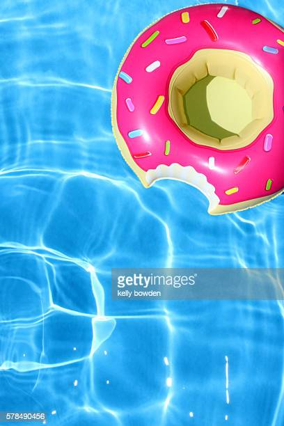 doughnut swimming pool inflatable - pool party stock pictures, royalty-free photos & images