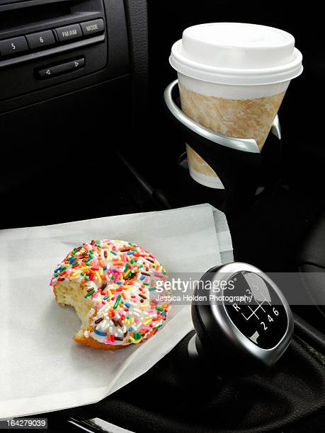 Doughnut with Sprinkles and Coffee, on the Road