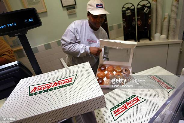 Doughnuts are boxed at the Krispy Kreme store April 15, 2004 in New York City. The shop was offering a free glazed doughnut to anyone showing a...