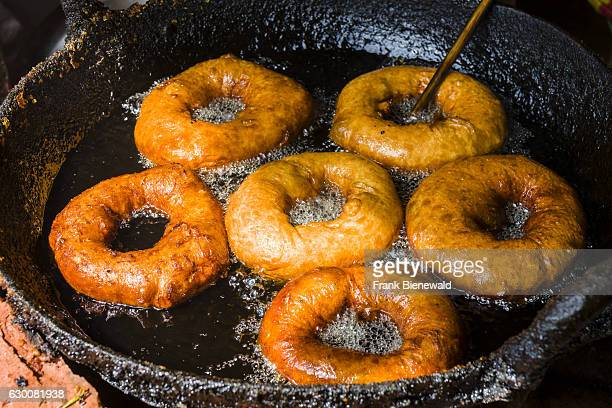 Doughnuts are fried in a pan with hot oil