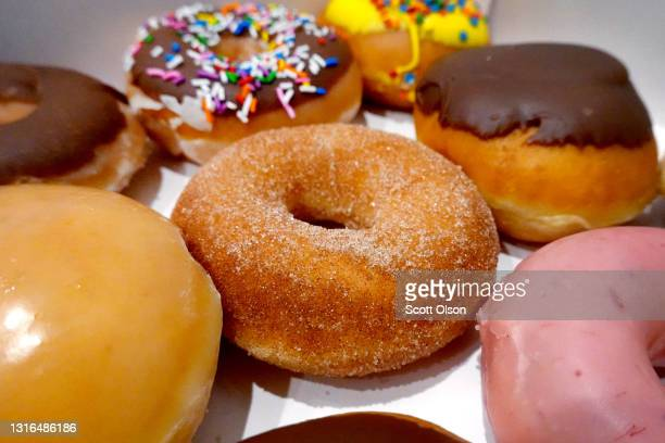 Doughnuts are sold at a Krispy Kreme store on May 05, 2021 in Chicago, Illinois. The doughnut chain reported yesterday that it plans to take the...